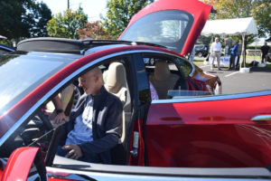 man sitting in electric vehicle